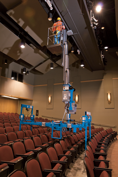 Genie AWP with super straddle working over theatre seating side view