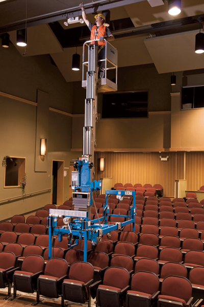 Genie AWP with super straddle working over theatre seating