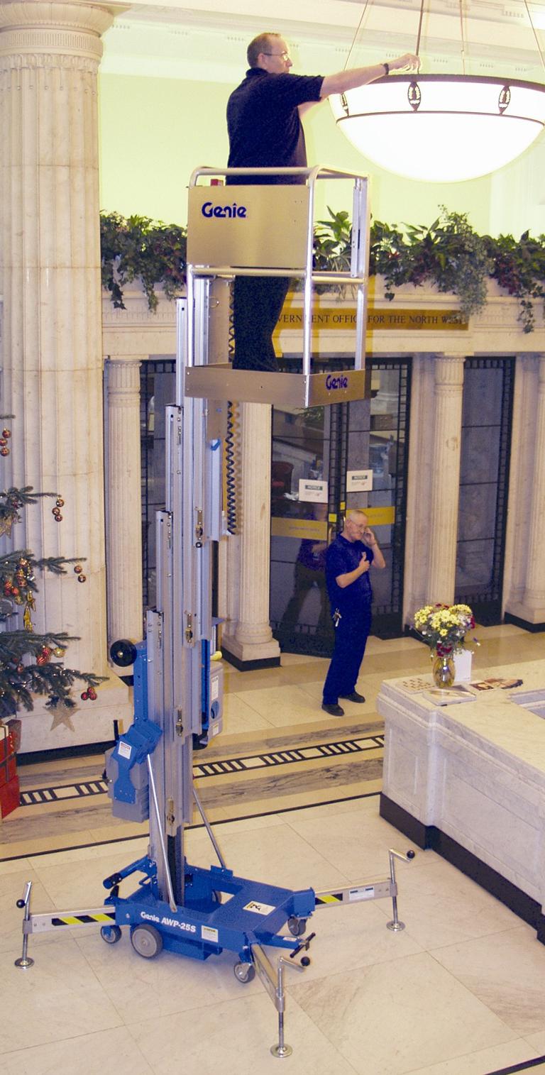 Genie lift AWP working on lighting in atrium