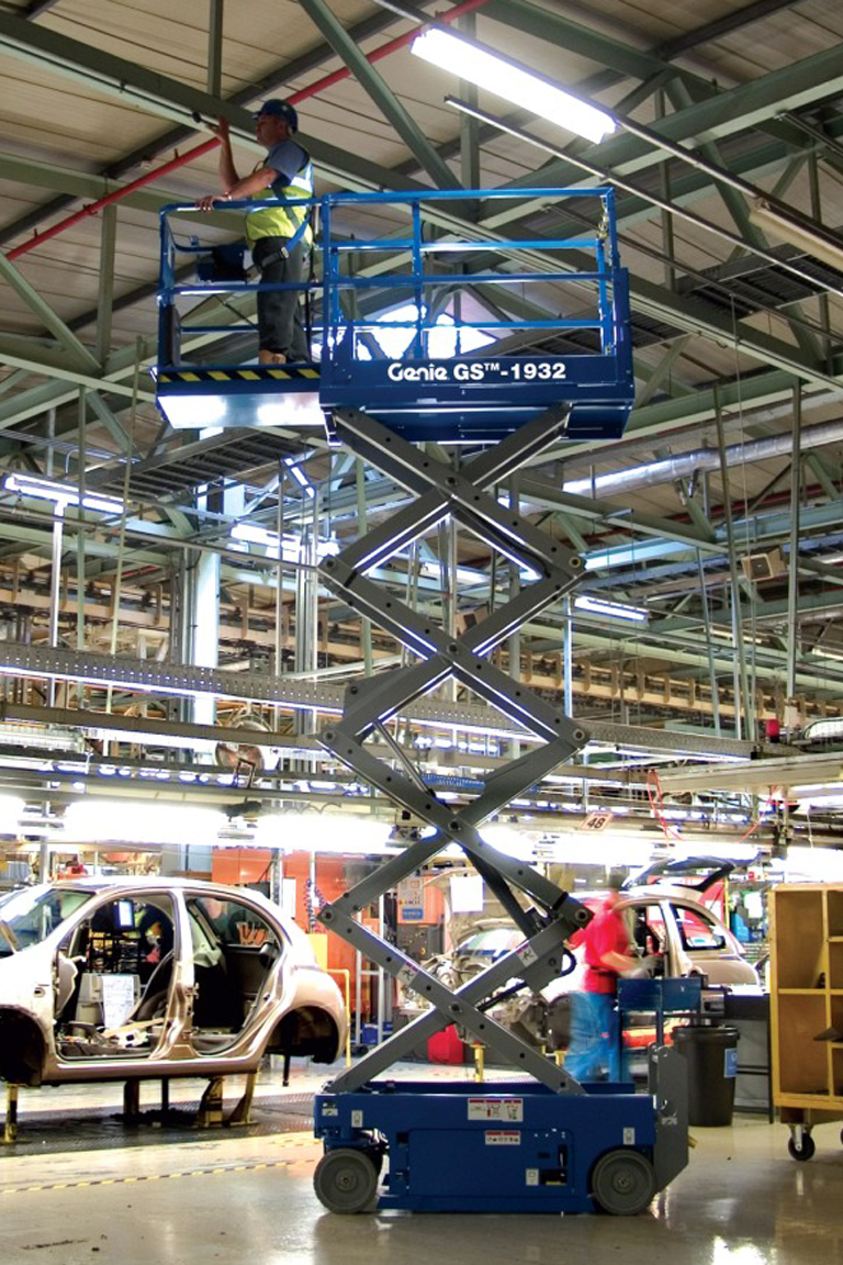 Genie electric scissor lift working in vehicle factory