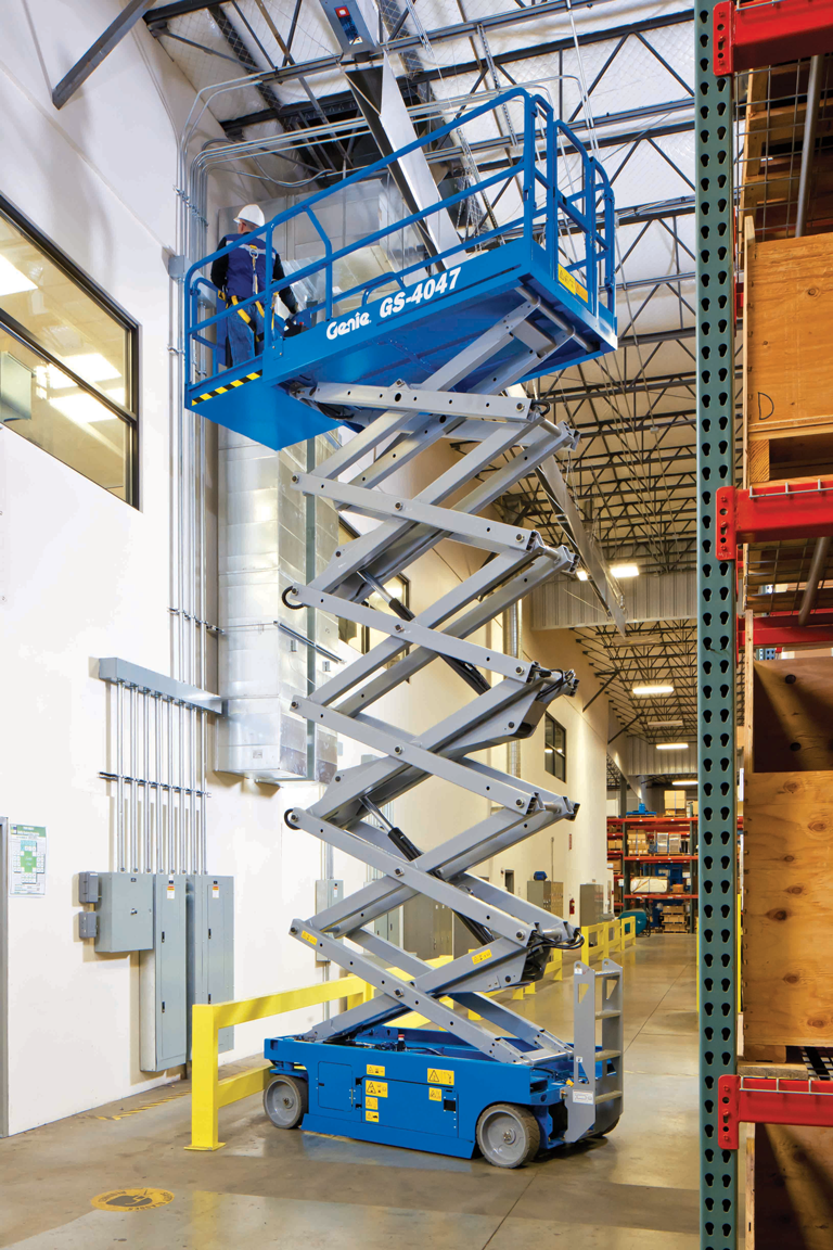 Genie scissor lift GS4047 working in a warehouse