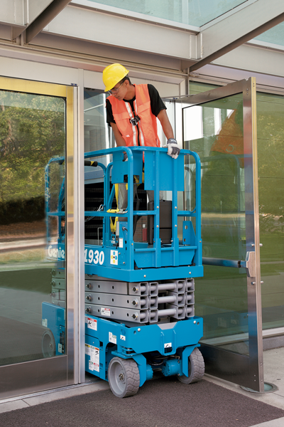 Genie electric scissor lift GS1930 driving through single doorway