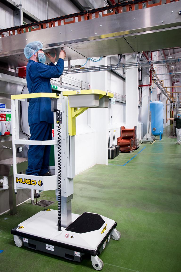 HLS Hugo lift working on conveyor maintenance