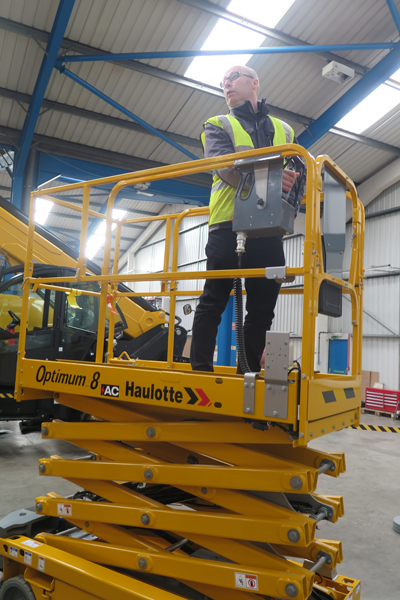 HLS very own Stuart on the Haulotte Optimum 8 electric scissor lift
