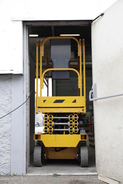 Haulotte Optimum 8 travelling through single doorway