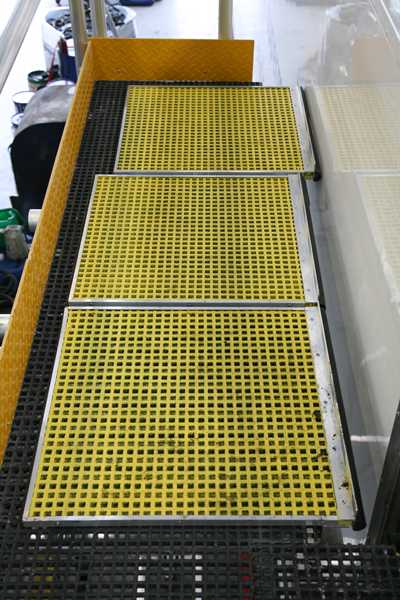 Closeup of sliding adjustable platform for vehicle maintenance