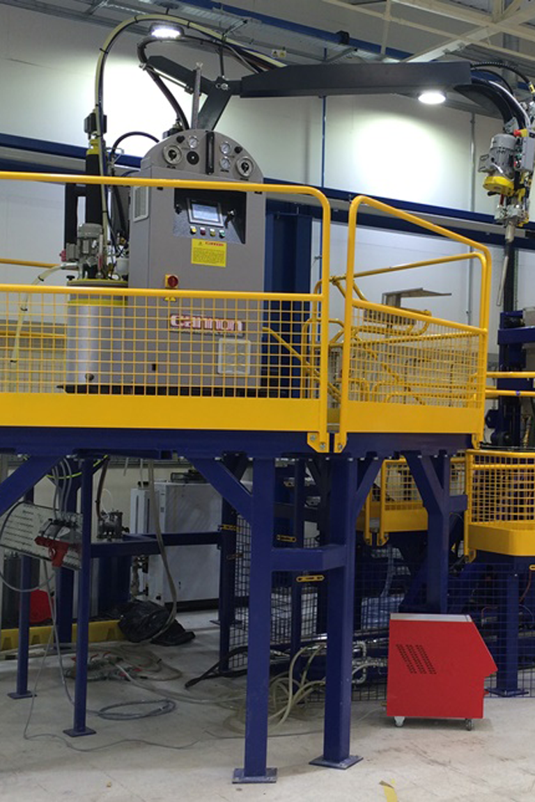 Bespoke gantry for accessing manufacturing equipment