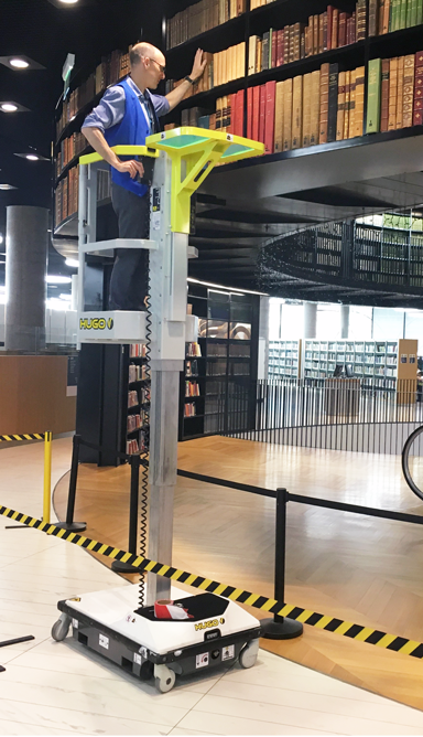 Hugo PAV vertical mast lift in a library