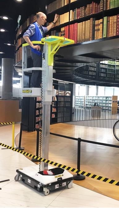 Hugo PAV vertical mast lift in a library