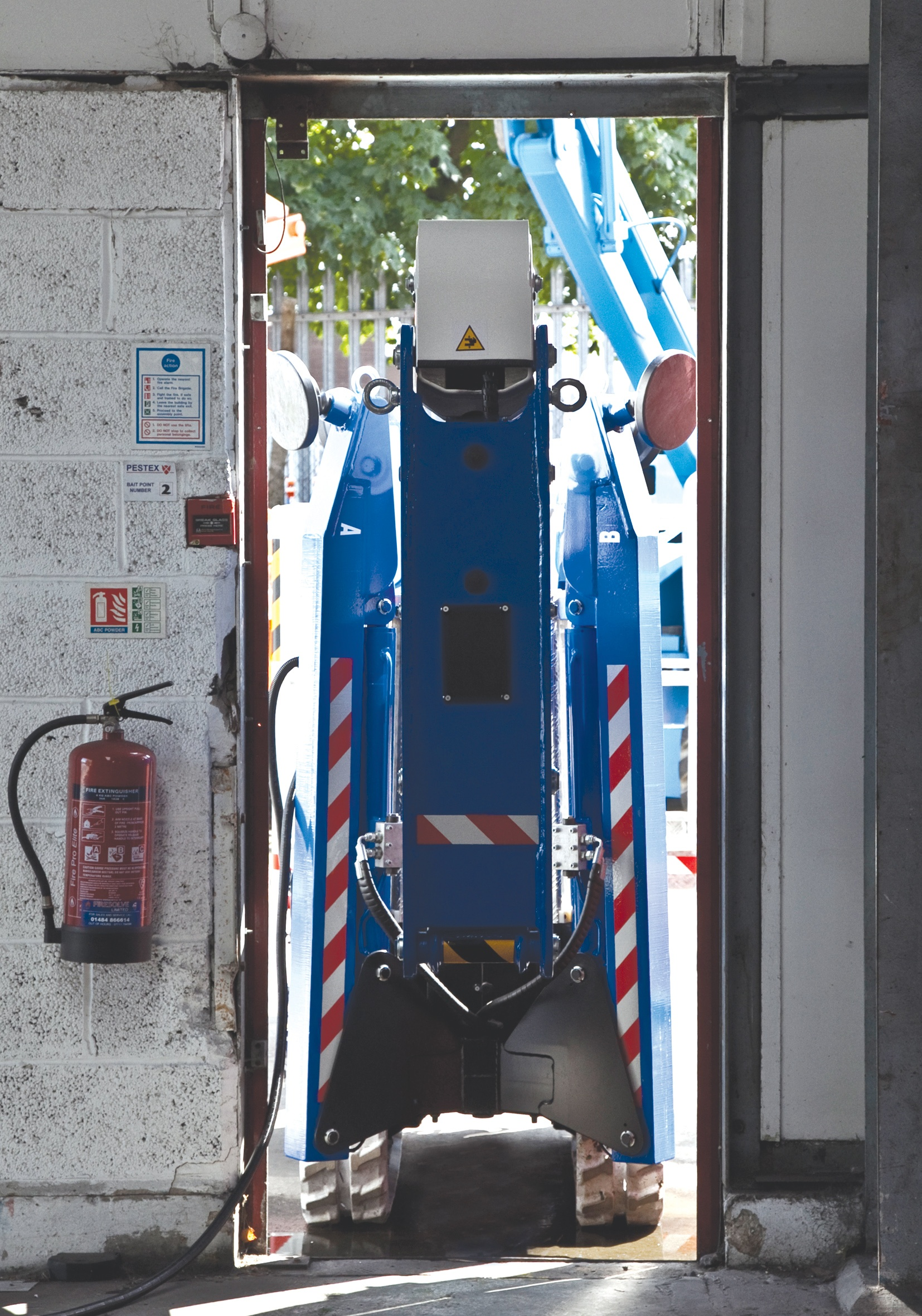 Bluelift spider lift travelling through narrow doorway