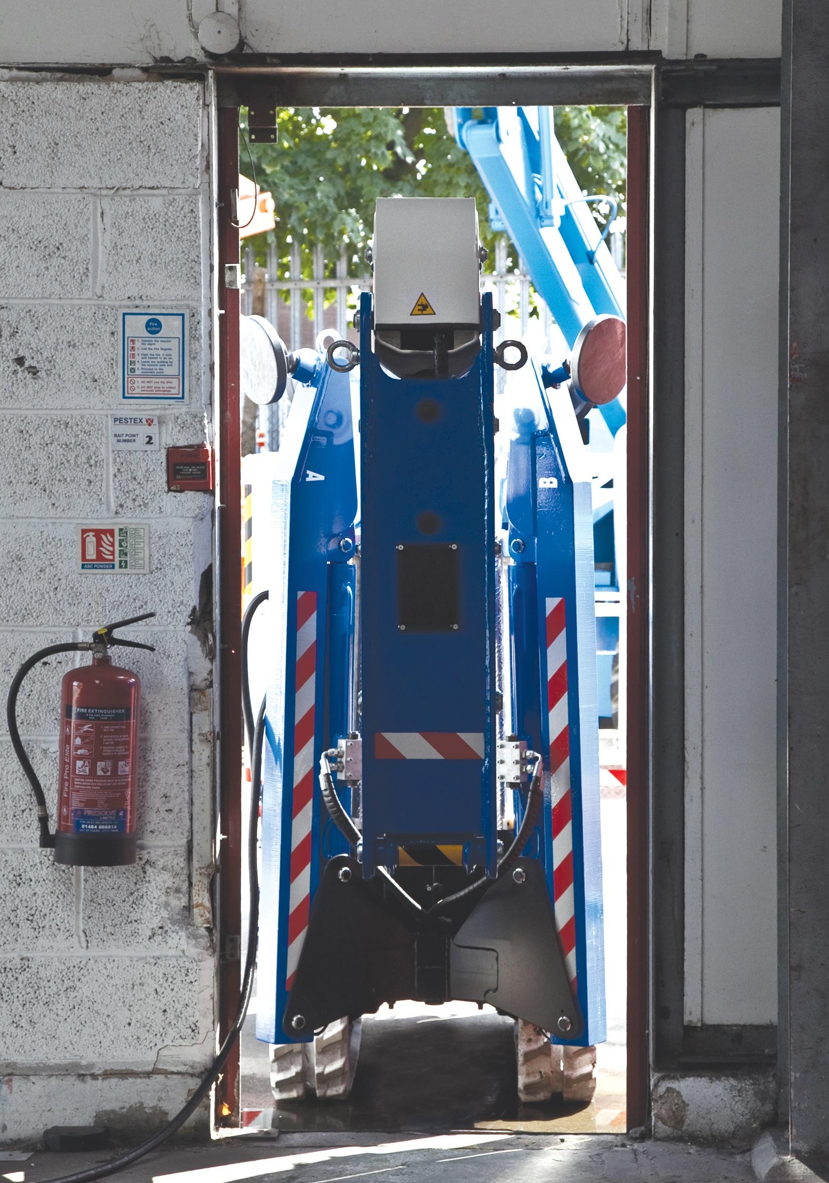 Bluelift spider lift travelling through narrow doorway