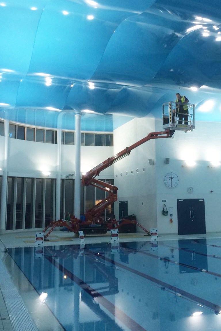 Lithium powered spider lift working over swimming pool